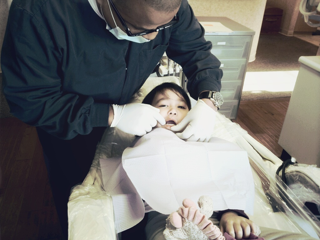 Getting sized up for a set of gold plated ice grills… JK  it's your first visit to the dentist… time to get rid of those sugar bugs.