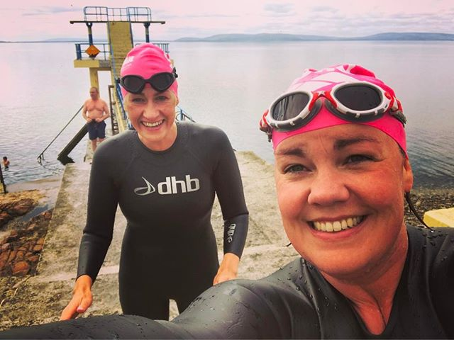 We may not have medals from the Iron man but we have these cute pink hats!! Conditions were perfect as @sologav says for my first swim out to coco 2k quickest time yet! With my iron maiden @myshopgrannylikesit #greattobealive no red card today!!! #ironman #healthy #healthyisthenewsexy #swim #galway #galwaybay @jameselwood I didn't need a lift back 😂