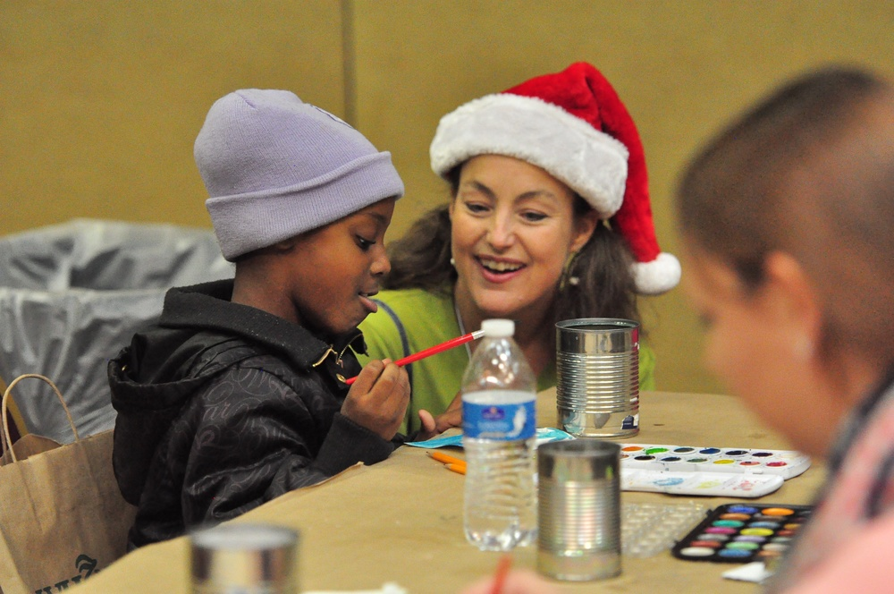 Volunteer and kids artist STRONG.jpg