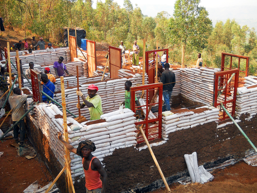 Masoro villagers building the first house using Earthbag construction technology.