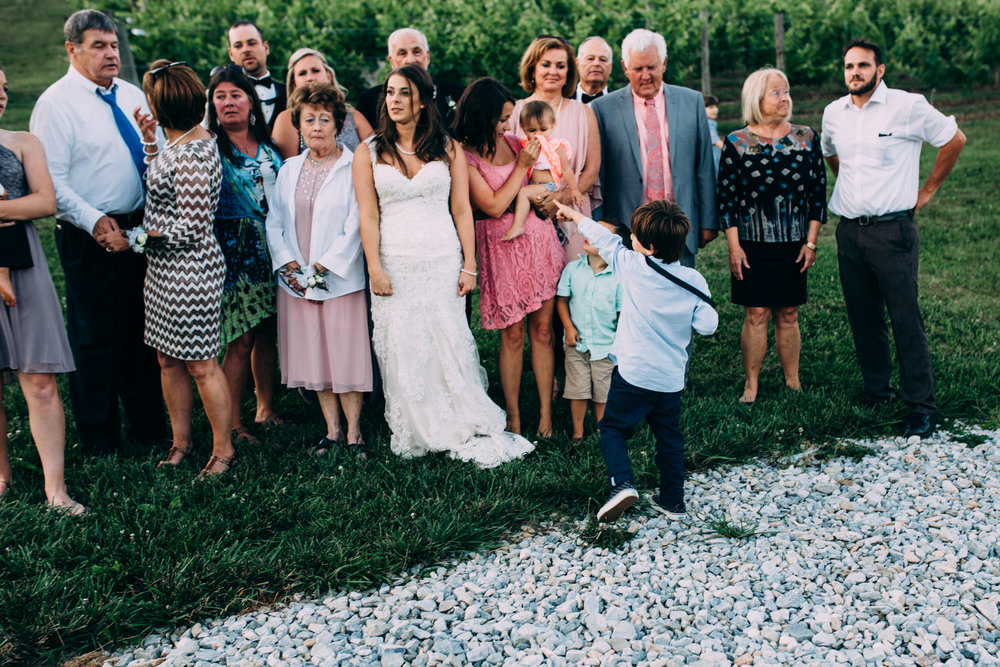 I'm committed to being an example. - Here's a photo of a wedding where I let my son jump with his instant camera and start directing the wedding party.