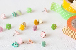 Cover them with Washi tape and make designer thumb tacks!