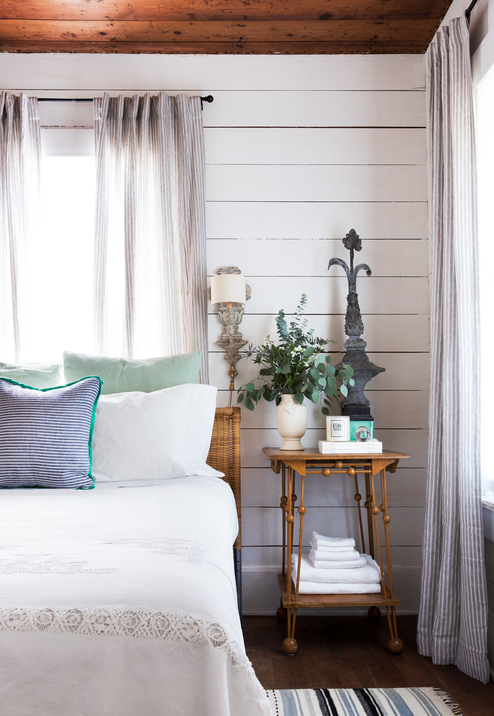 Avery Cox Design- Austin Texas East side bungalow featuring custom styling by Avery Cox. Antique oak stick and ball table with French painted sconces and shiplap walls.