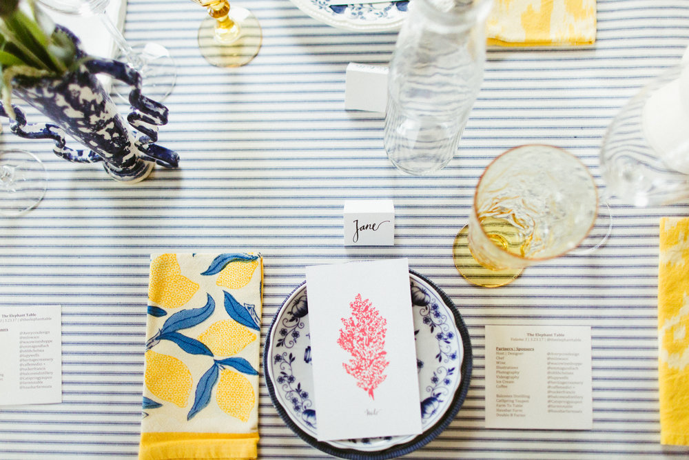 Blue and white ticking stripe table cloth with Lisa Corti accents at this Elephant Table pop up dinner in Austin, TX
