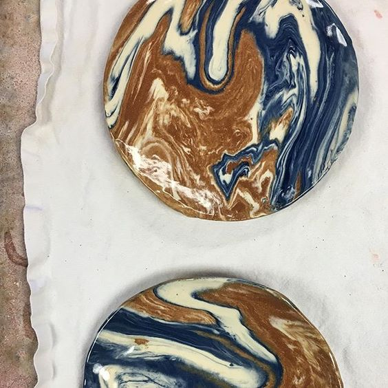 Miguel Flores Vianna marbled ceramic plates with ochre, white, and cobalt blue