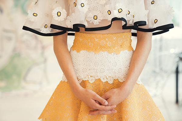 Carolina Herrera yellow lace and daisy dress detail- black trim and layers of chiffon