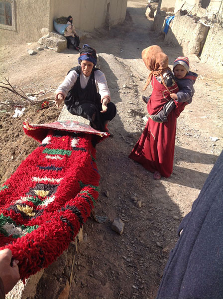 Buying a bright carpet from a women in the Middle Atlas mountains