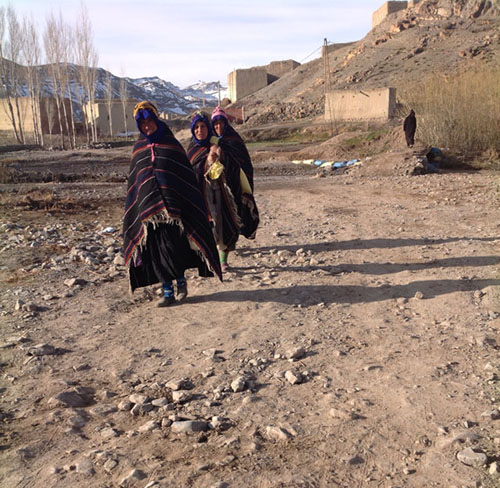 Women coming to a market in the High Atlas mountains, wearing handowven shawls