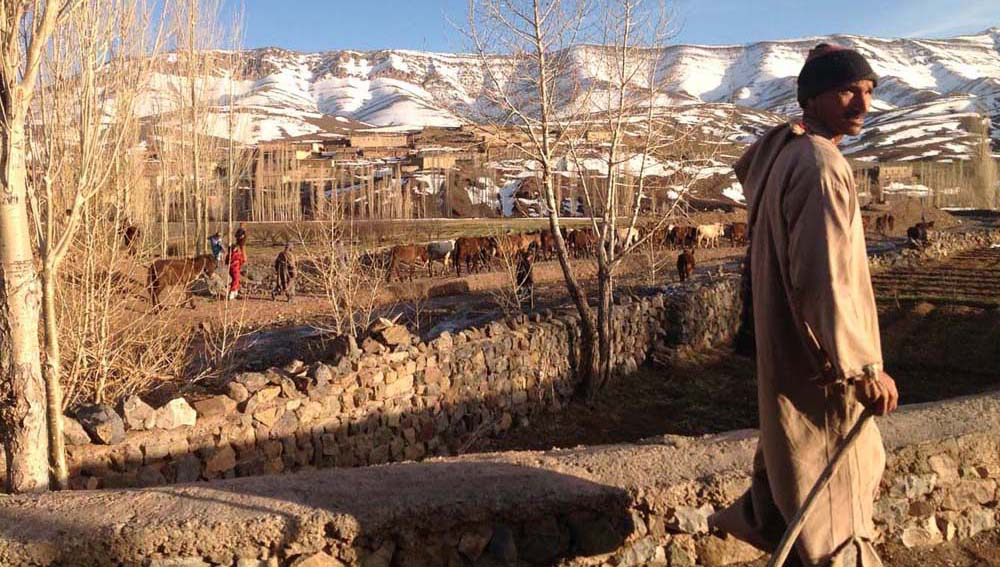 A Berber friend leads us into a small village in the snow capped mounatains