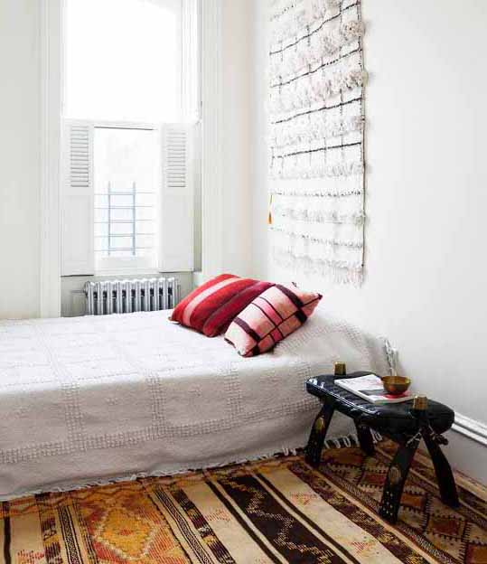 Brooklyn home of author Julia Chaplin Photo from One Kings Lane. This kilim uses warm yellow and orange alongside natural undyed dark brown