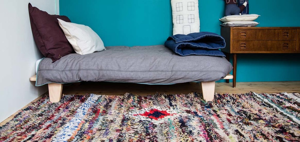 A Maroc Tribal vintage boucherouite rug, with  Camomile London 's stylish nursery and children's bedding