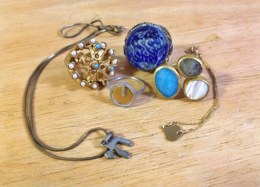 Rings from Spain, Turkey, Dubai, Hungary. Necklace from Israel and bracelet from France.