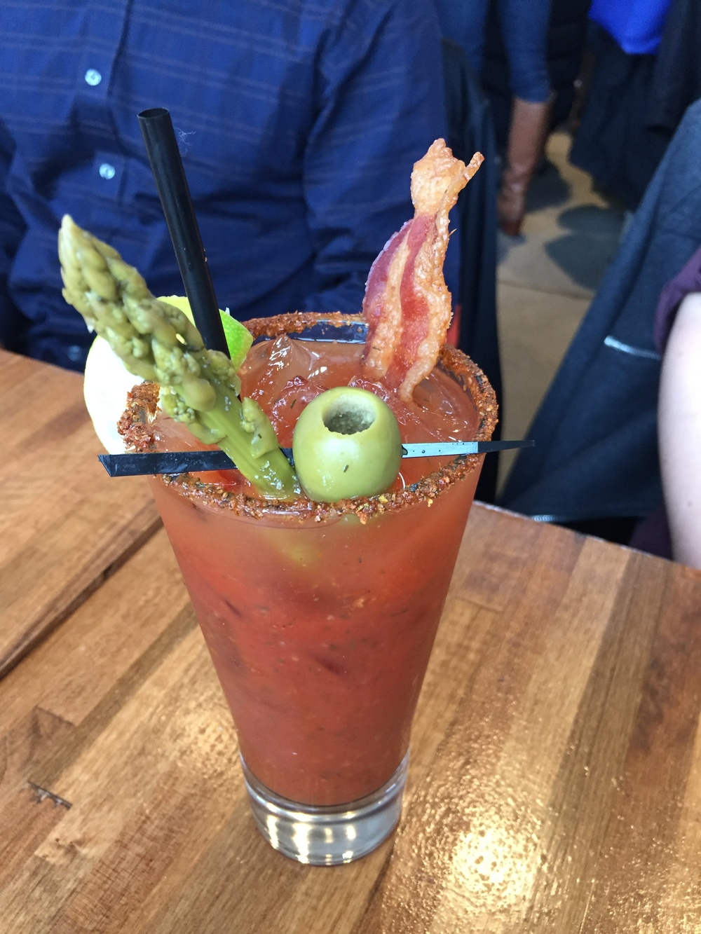 That olive is a little ball of evil, but I can get behind a drink garnished with bacon and pickled asparagus. Noms-a-fucking-hoy.
