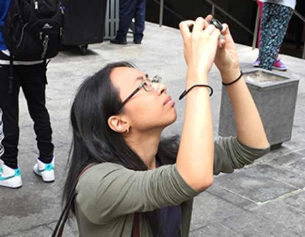 Karen Zhang gets to know her camera outside the Multimedia Team Headquarters at 153 East 53rd Street.
