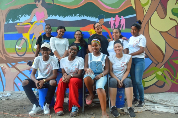 """The Creative Keepers"" in front of the new mural at the entrance to Isham Park. Back Row: Teaching Artist Assistant Kito Kirtley, Johanna, Alsyssa, Elsie, Camila, Kiara. Front Row: Ellington, Trevonna, Teaching Artist Jocelyn Goode-Morgan, Nicole."