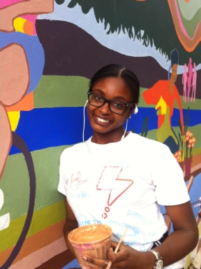 Trevonna in front of the New Mural at Isham Park