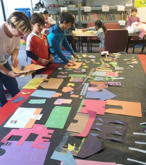 CAW Teaching Artist Angel Thompson demonstrates how to make cutouts at the United Palace of Cultural Arts in Washington Heights.