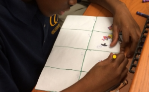 From inspiration to outline: A student at Global Tech Prep creates a storyboard.