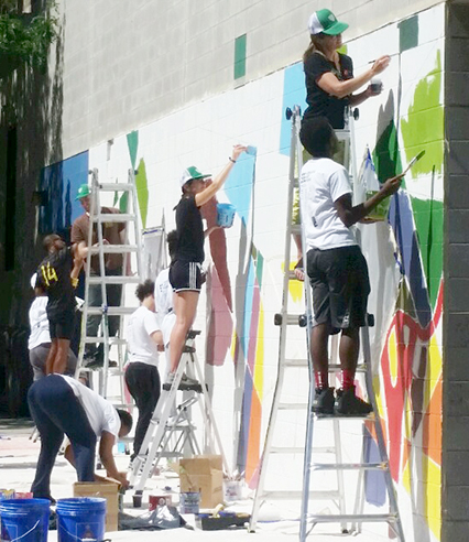 Youth Apprentices at work on CAW's third mural for PAL Harlem Center.