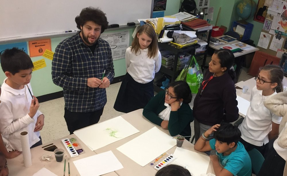Zack Podgorny    gives a watercolor demonstration to middle school students in the after-school painting and drawing program at    PSMS 278   .