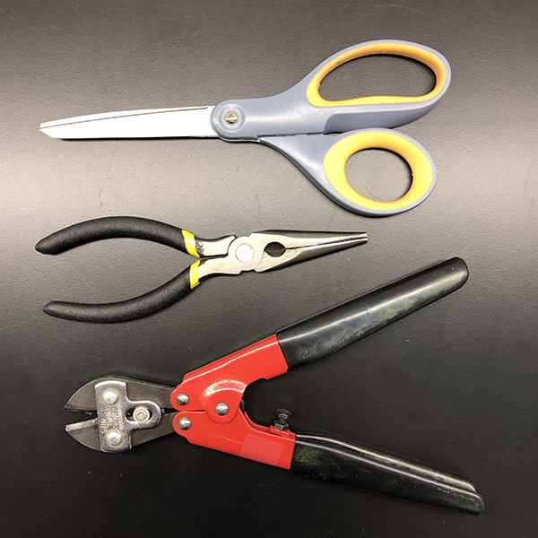 You will need a pair of    scissors   , a    wire cutter    and a    pair of pliers   . Needle-nose pliers make nice round curves, but regular pliers will do the trick.