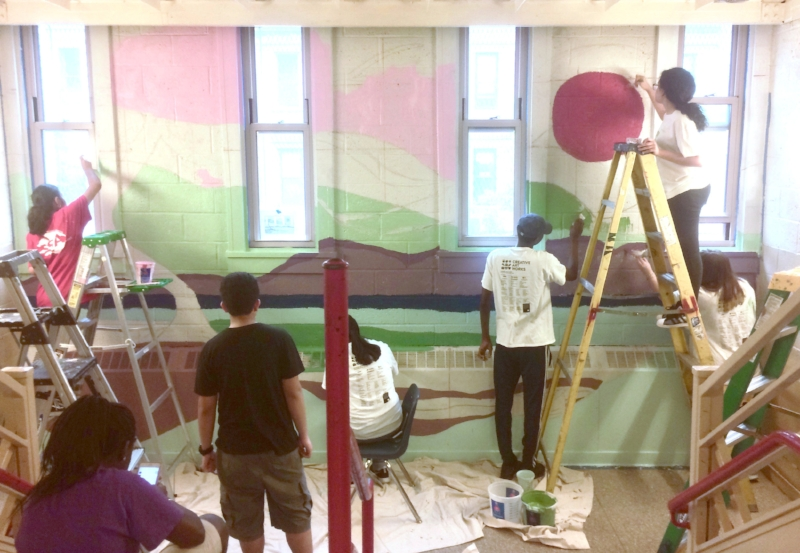 Students work on at Mental Health by Design mural in the stairwell of the at Louis Brandeis School Campus on the Upper West Side. The MHxD program recently won an international Seed award.