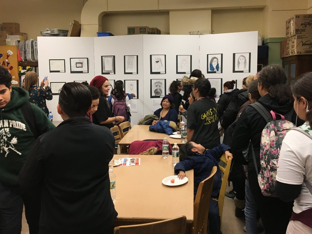 At the opening of a pop-up gallery of student drawings at MS 45 in Fordham, students acted as docents for each other's work, which reduced the pressure to talk about themselves.