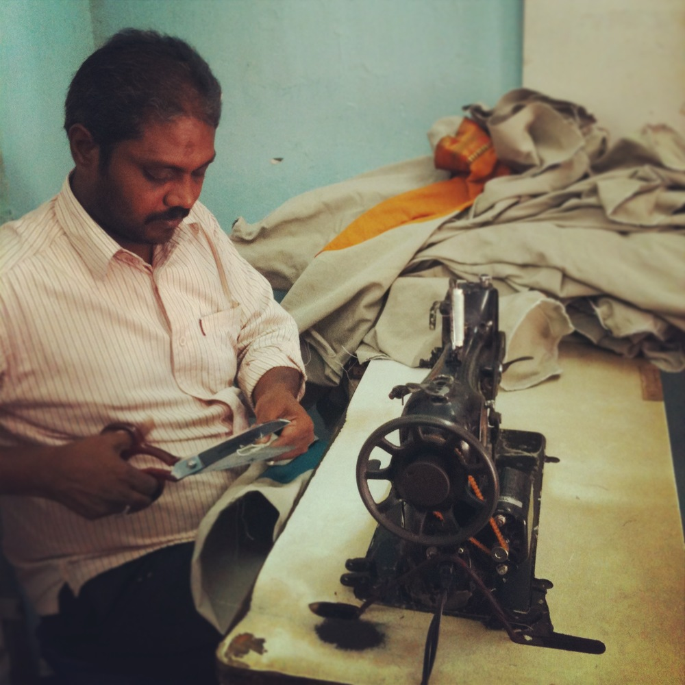 Assam's assistant as he skilfully sewed each individual bag.