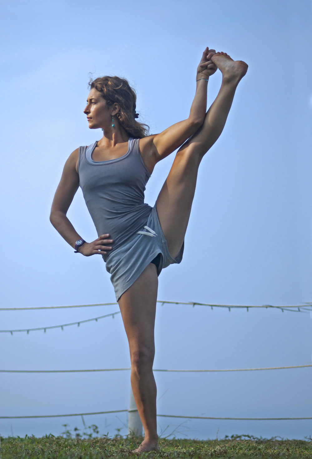 """Utthita Hasta Padangushthasana"" (One Leg Balance Posture, Soul and Surf, India)"