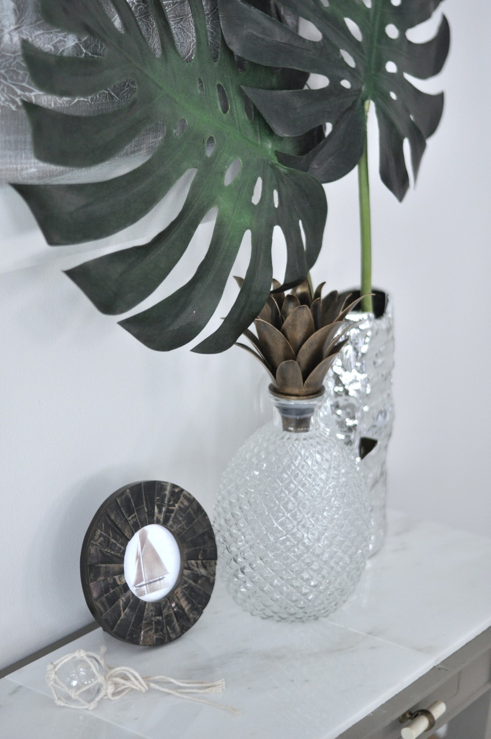 Lush Palm Leaves + A Curious Pineapple Artifact To Welcome Home