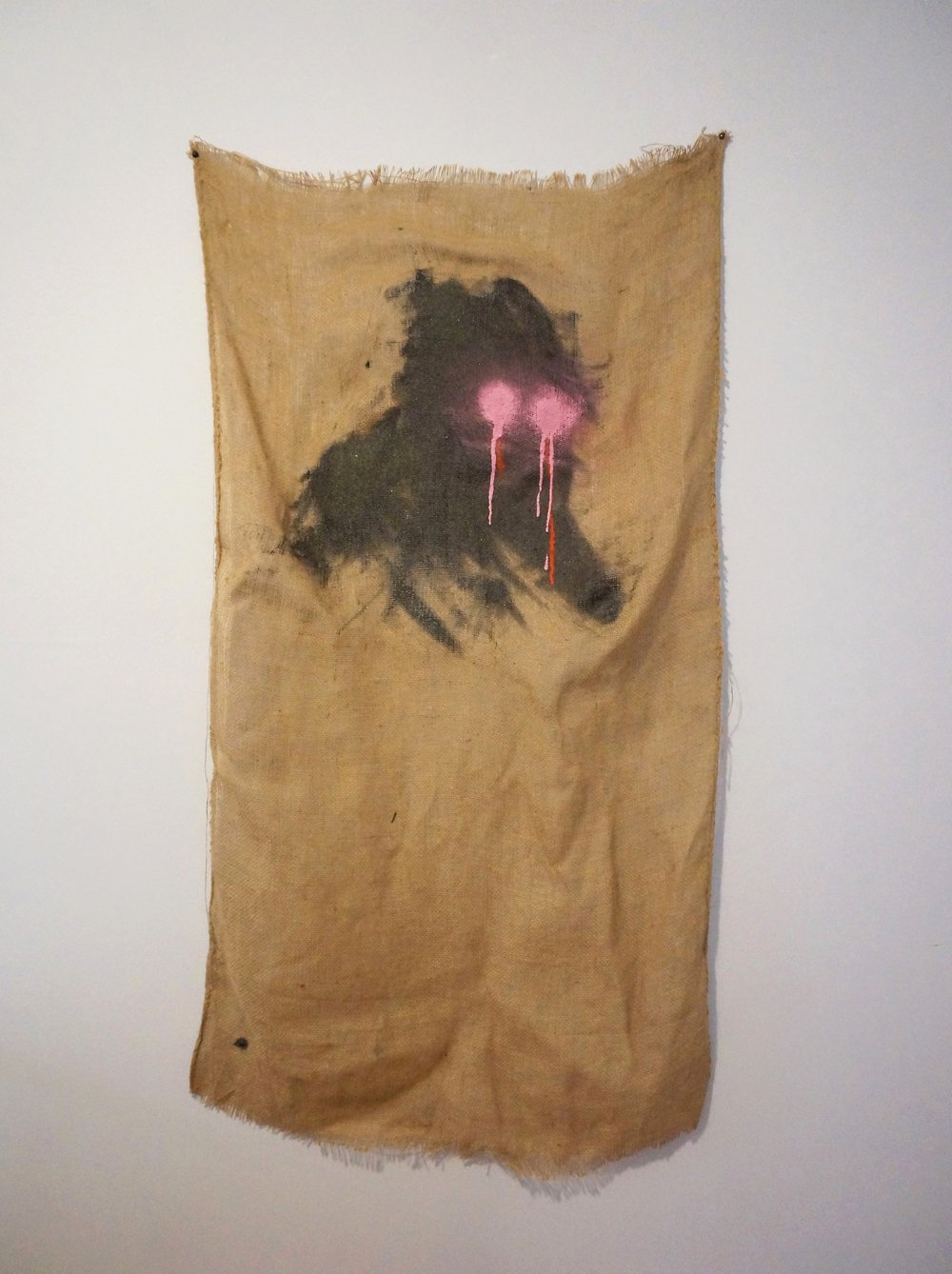 Almost Human, 2017, burlap, spray paint, resin, sand