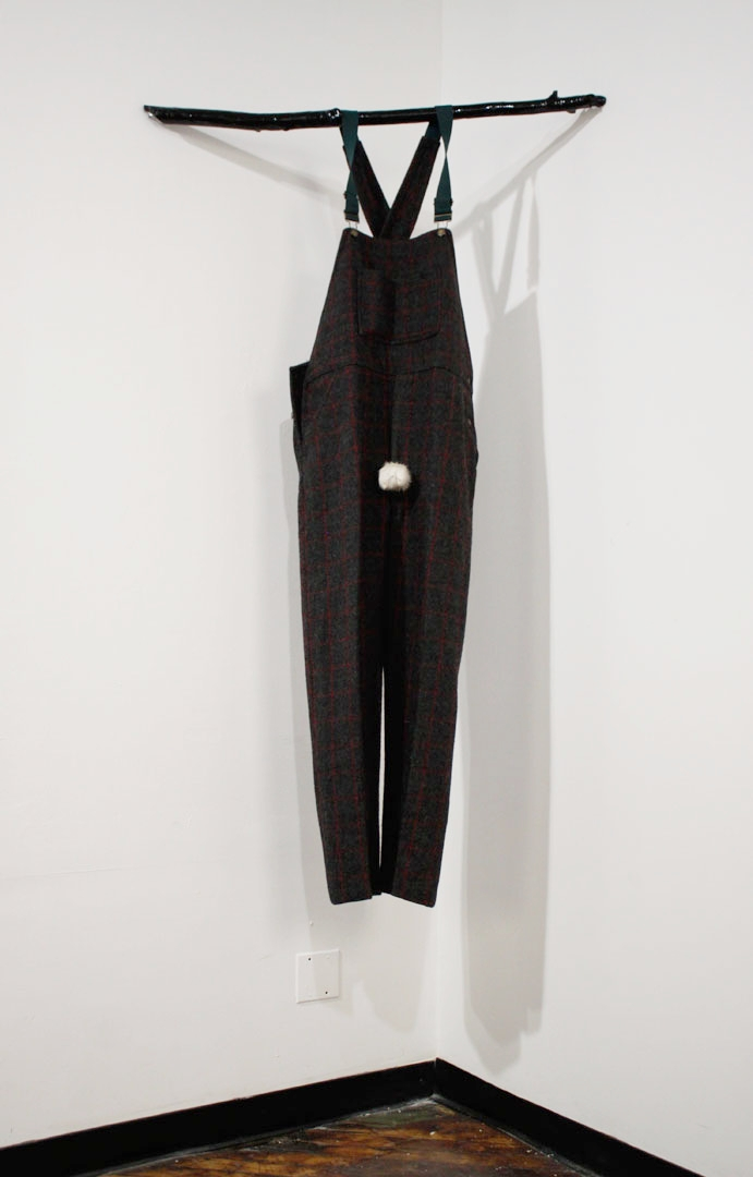 """Turn to Me, 2016, wool pants, suspenders, deer scrotum, wood, resin, 60 x 30 x 7"""""""