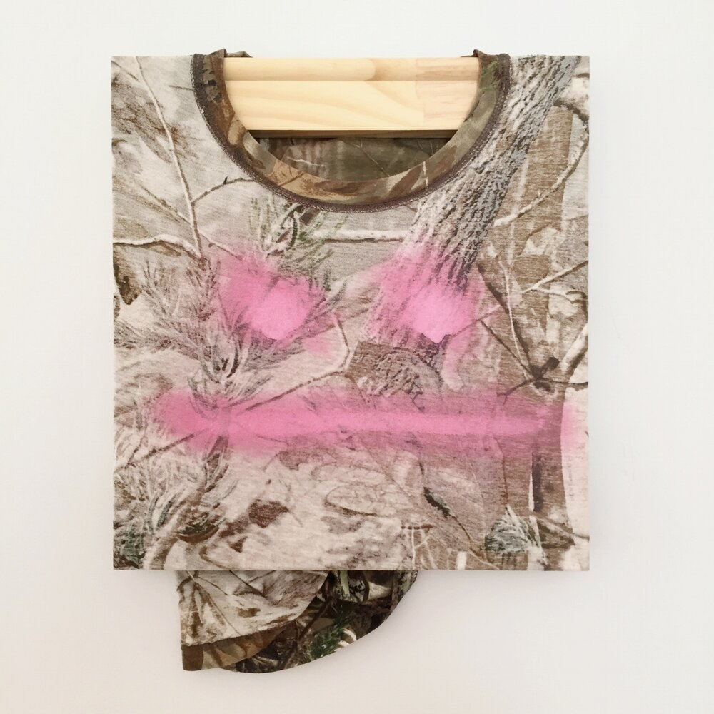 Here Comes Trouble, 2017, shirt, wood stretcher, spray paint, 16 x 14in