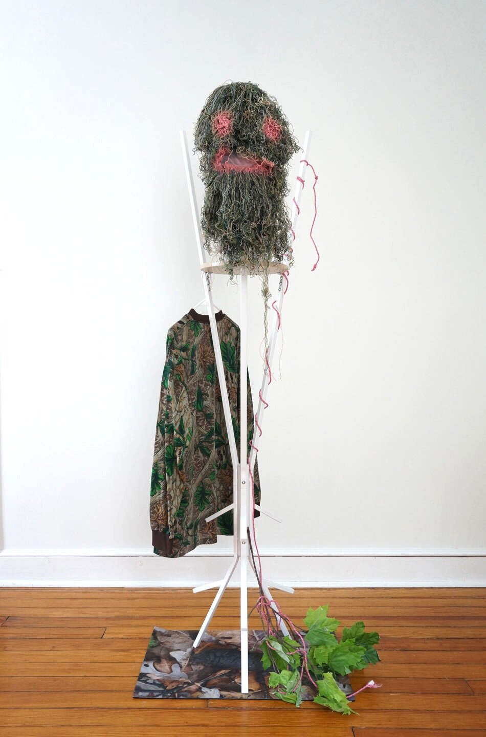 Lets Figure this Out Together, 2019, thread, acrylic, steel, artificial leaves, rubber, rope, shirt, 71 x 24 x 30in