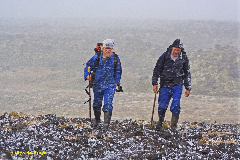 Chris Oosthuizen and Martin Haupt in a snow storm, on route to do some seal work at Marion Island. Photo credit: Nico de Bruyn