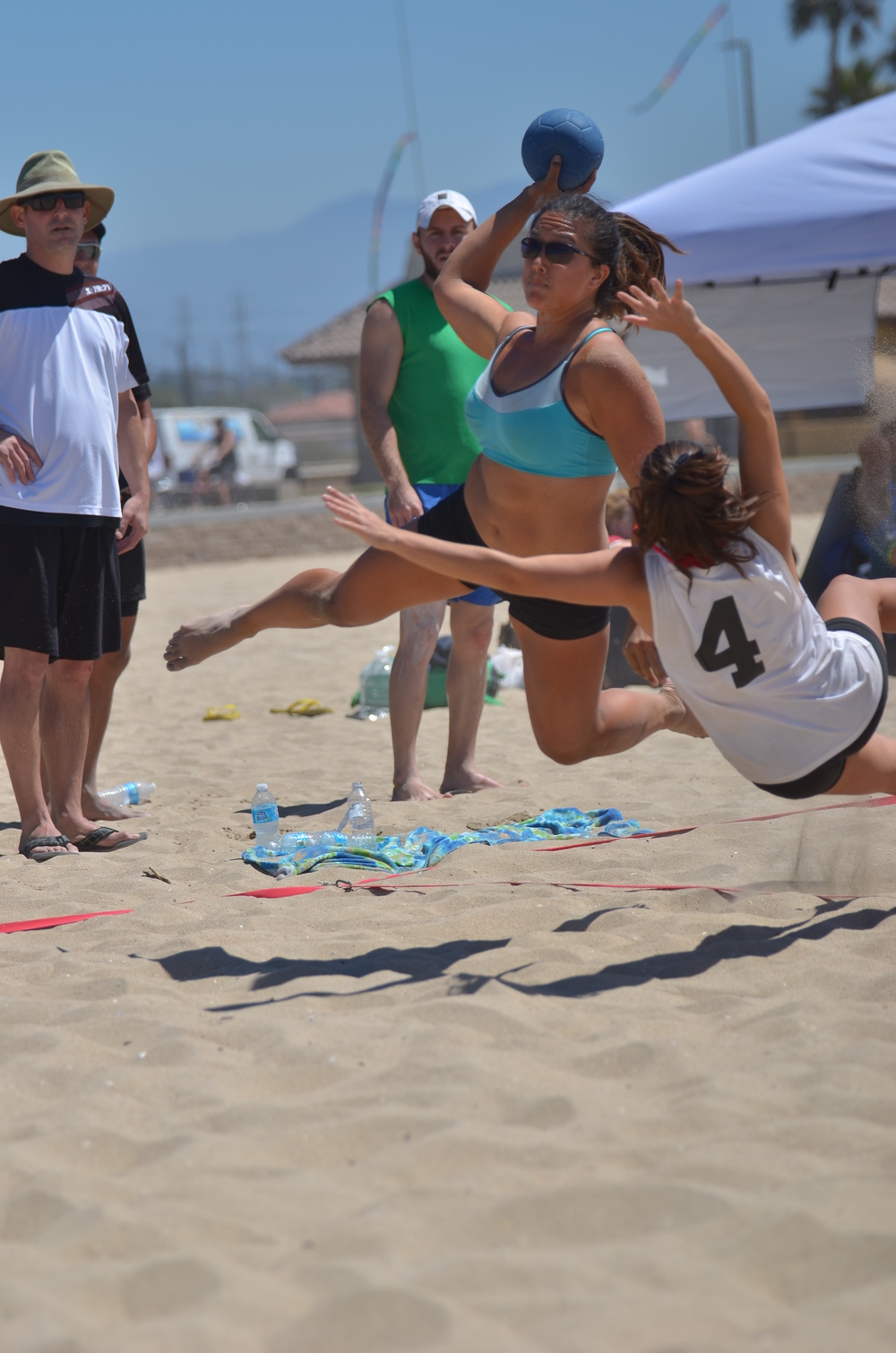 Rachel Wong from LAWTHC in a jumping shot at the 2013 beach handball games in LA. Photo by Atticus Overbay, LA Team Handball photographer