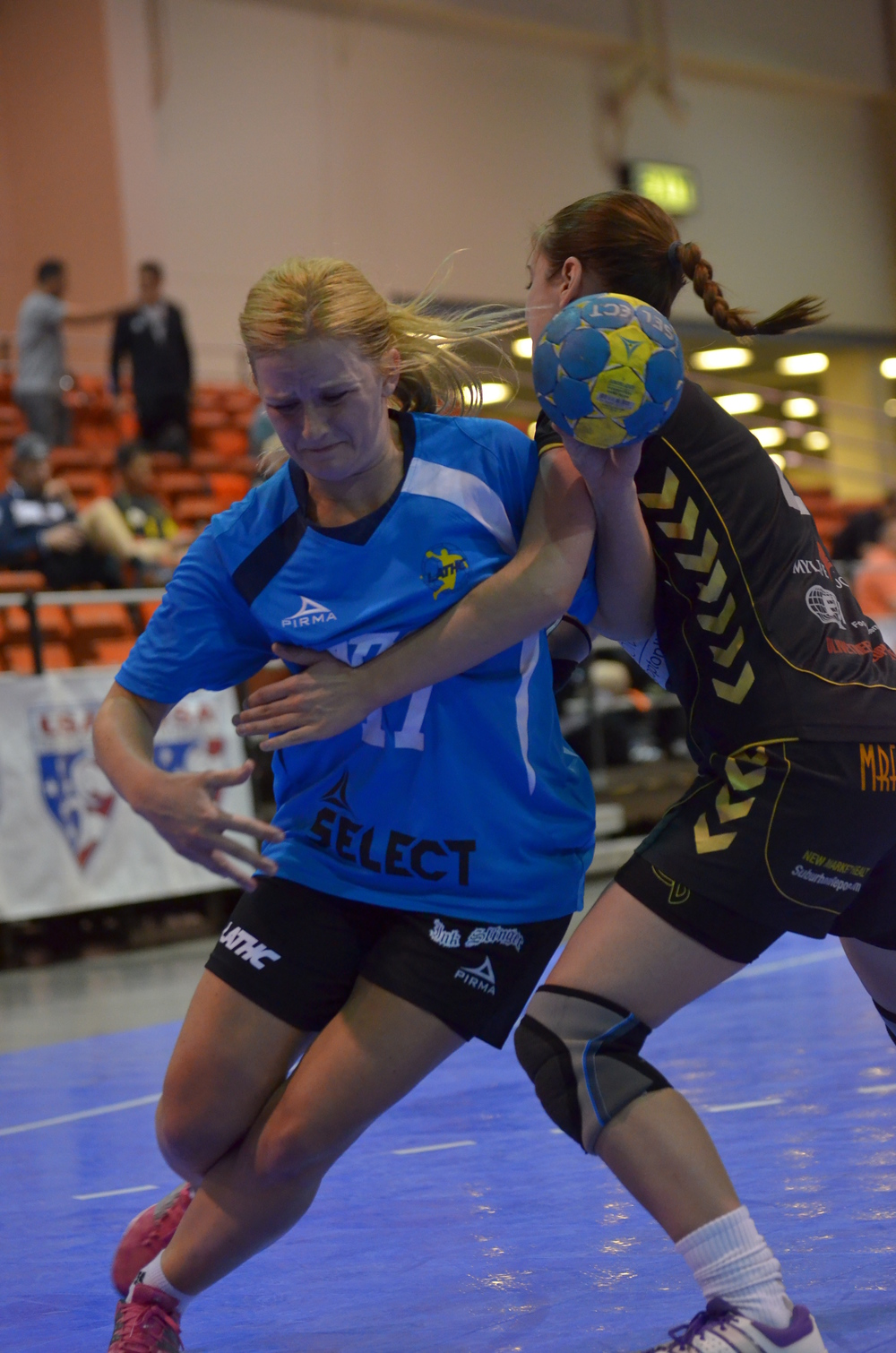 The fast Swedish wing player Jennie Johansson trying to break through a clinging defensive player at a national game. Photo by Atticus Overbay, LA Team Handball photographer.