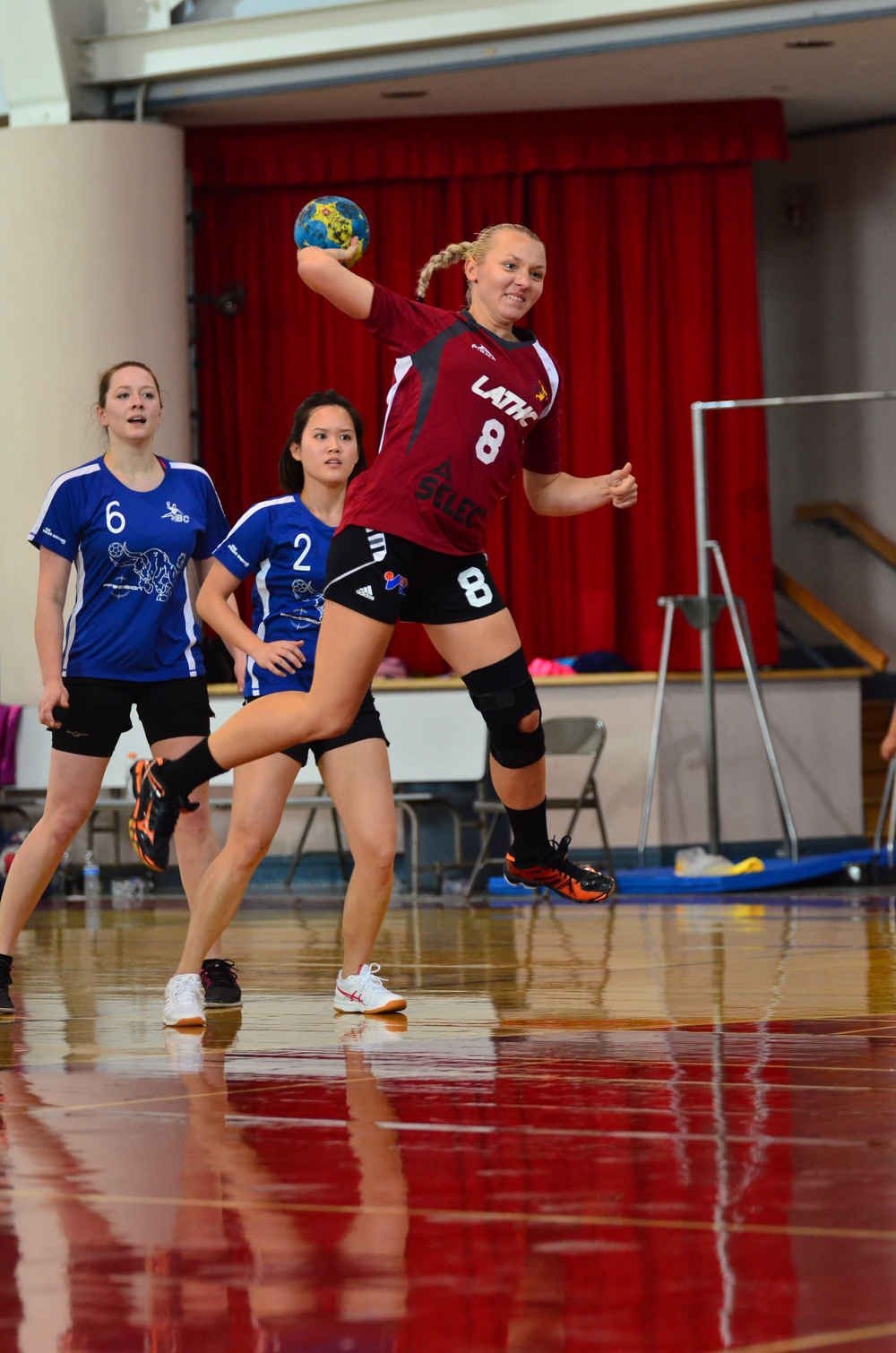 The steady LA back and wing player Olga Bunton in a jump shot. Photo by Atticus Overbay, LA Team Handball photographer