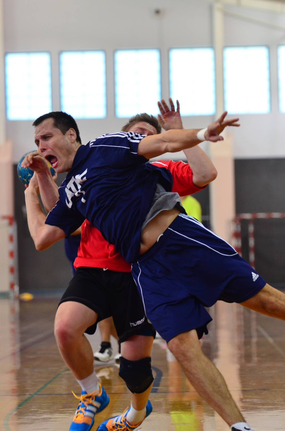 Vladimir Andjelic, LATHC player fighting for the win. Photo by Atticus Overbay, LA Team Handball photographer