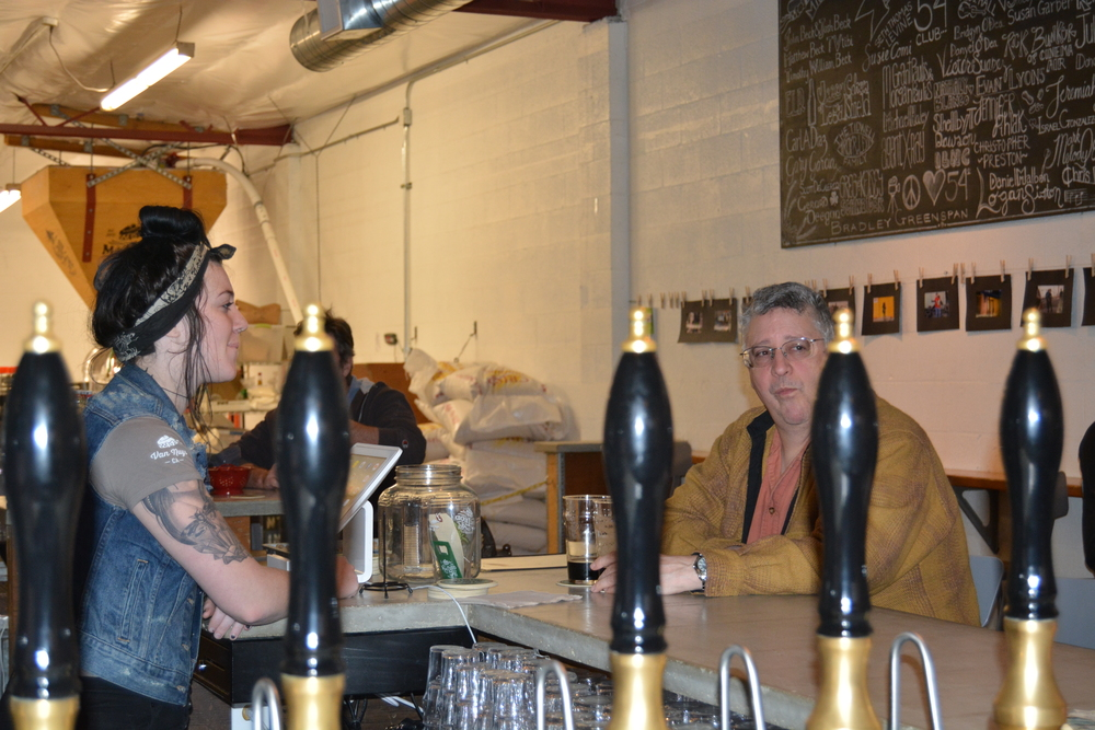 Beer maiden, Nicole Geletka, waits on a MacLeod Ale Brewing Co. regular, Omar Cruz, as he ponders the selection of his next drink. Photo: Lauren Holmes