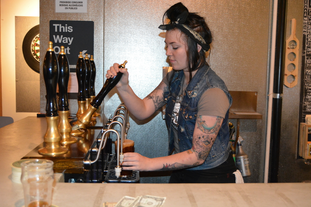 Former art major Nicole Geletka traded in her paint brushes and pastel to master the craft of brew pouring as a beer maiden at MacLeod Ale Brewing Co. in Van Nuys, Calif. Photo: Lauren Holmes