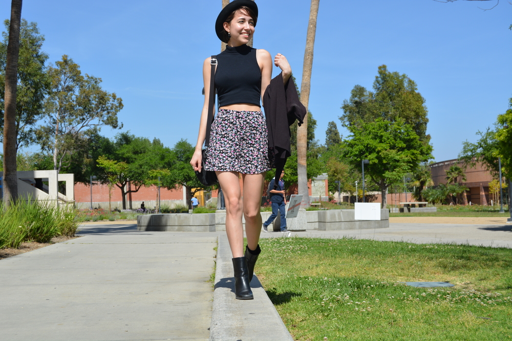 CSUN bargain shopper Isabel Yuvienco snagged her Coach purse from an outlet to go along with her floral skirt from Cotton On and Forever 21 turtle neck crop- top and boots. Her black cardigan is courtesy of Urban Outfitters. Photo: Lauren Holmes