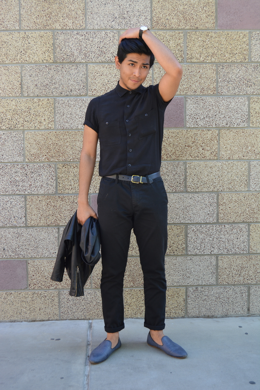 Jose Lopez is sporting a pair of Obey cuffed black dress pants, blue Asos shoes from House of Hounds and a black short sleeve two pocket shirt from American Apparel. Photo: Lauren Holmes
