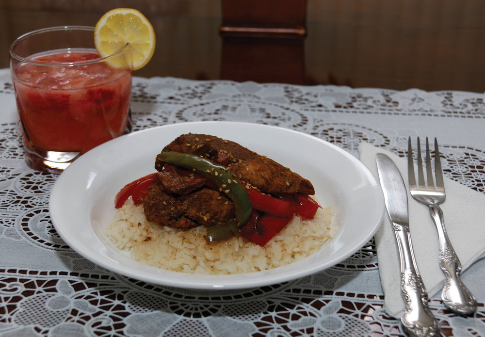 Strawberry lemonade drink paired with pepper chicken and rice entree for lunch. Photo by Vanessa Saenz.