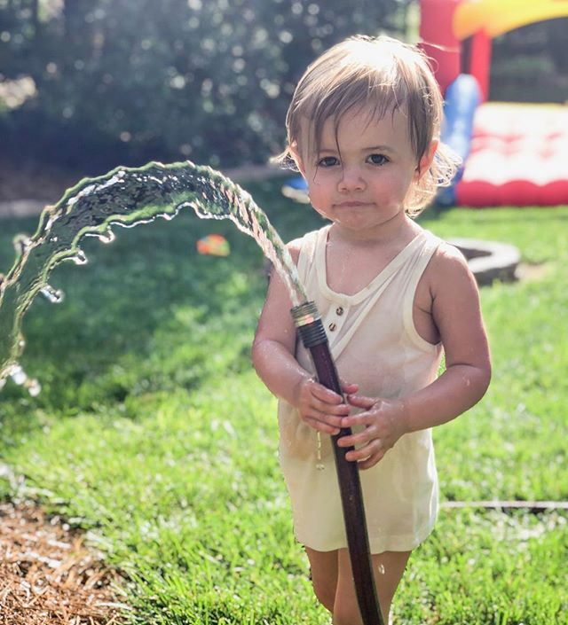 This small, hose-obsessed human has been dealing with big emotions and making the most routine experiences extra challenging for me. It feels like we don't talk enough about how HARD each phase of parenting really is. And yet, I'm well aware of how fortunate I am to not live in fear of her being ripped away from me, simply for trying to give her a better life. These are rough, disheartening days. Hold your people extra close and keep fighting for the children and their parents. Today, on World Refugee day, let's all donate to the cause. I just gave to @raicestexas in a matter of two clicks. Every dollar can help. 📷 @inhercompany