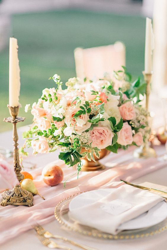 We could make the floral arrangement smaller, add a table runner, add tall candles, and glass chargers. Surprisingly, this can be $220+ per table. Glass charger plates can be anywhere from $5-15 each, depending on your area. So for this centerpiece $220 x 30qty = $6,600