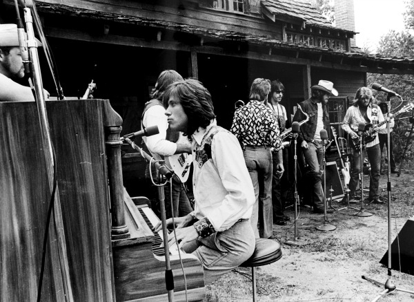 The band Chicago performs in front of the DeLonde House in 1974. - not by author