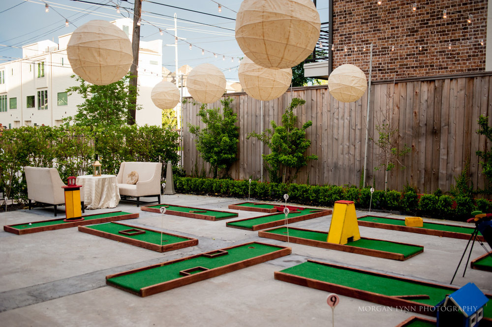 Such a fun and unique idea. This couple set up 9 holes of putt putt golf for their guests to enjoy!