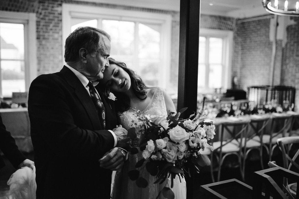 Such a sweet moment captured with the bride and her father just before walking down the aisle.