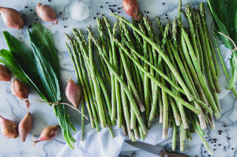 Asparagus, shallots and recao. Ingredients to make recao risotto.